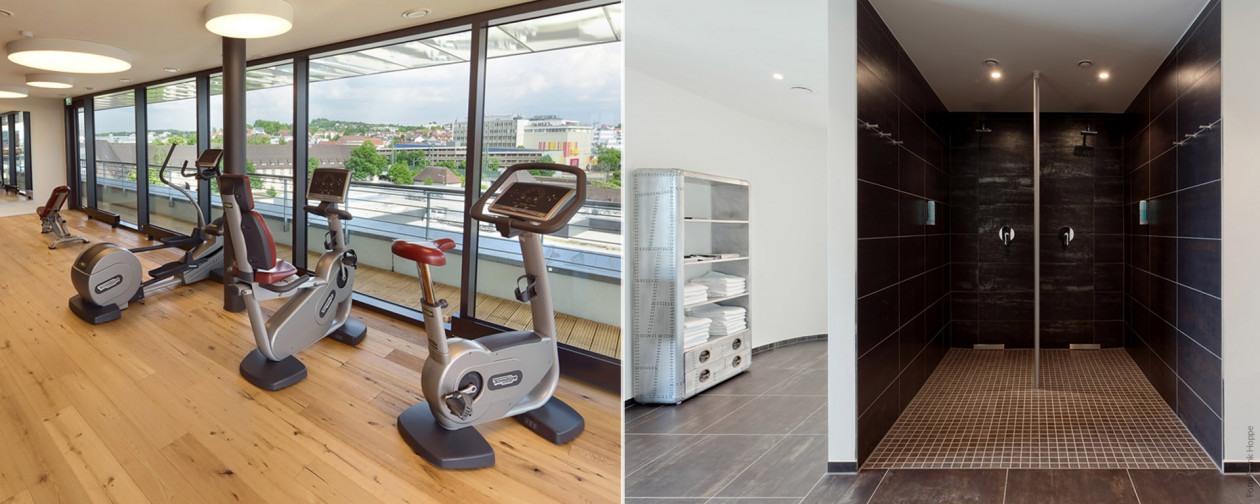 V8 HOTEL Lifestyle-Hotel - Fitness-Geräte in der Fitness-Lounge mit Panorama-Blick, Erlebnis-Duschen und Relax-Liegen.